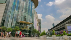 Time-lapse of tourists visit Siam Paragon Luxury Department Store Stock Footage