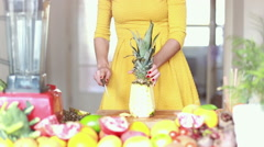 Stock Video Footage of View of woman hands cutting pineapple