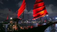 Traditional wooden cruise ship with red sails on tourist tour trip in Hong Kong Stock Footage