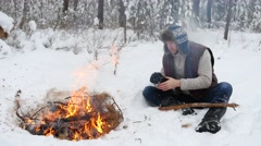 Man Warm Hands by Winter Campfire Stock Footage