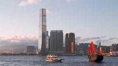 Wooden sailboat in Hong Kong harbor at evening twilight. Asia landmark cruise Stock Footage