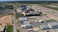 Aerial view of hurricane damage to airport hanger at Gulfport-Biloxi Regional - stock footage
