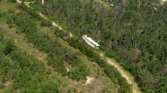 Orbit of riverboat upright in a wooded area placed there through forces of - stock footage