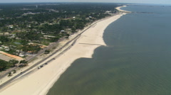 Flight along Beach Drive, Gulfport, Mississippi with views of neighborhood - stock footage