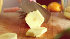 View of woman hands cutting pineapple into slices - stock footage