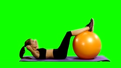 Woman in gym outfit excercising with a pilates ball, Green screen Stock Footage