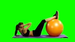 Sport woman in gym outfit excercising with a pilates ball, Green screen Stock Footage