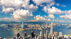 Aerial view of Hong Kong city skyline with high modern skyscrapers at sea harbor Stock Footage
