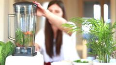Woman blending vegetables Stock Footage
