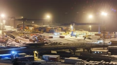 Port activity at heavy snow. Cargo trucks transporting containers from and in Stock Footage