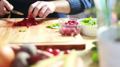 View of man hands cutting raspberries - stock footage