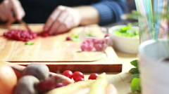 View of man hands cutting raspberries Stock Footage