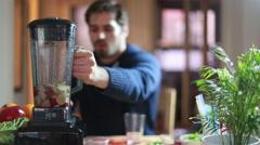 Man blending fruits in blender - stock footage