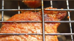 One slice of grilled juicy pork steaks over coals, on the brazier, close up Stock Footage