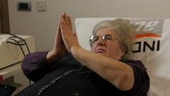 Old female patient doing physical exercises for recovery hands. Arkistovideo