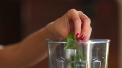 Close-up of putting spinach and cherry tomatoes into blender Stock Footage