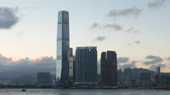 Tall skyscrapers on Kowloon side of Hong Kong at sunset. Moving clouds timelapse Stock Footage