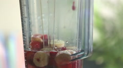 Close-up of blending fruits - stock footage