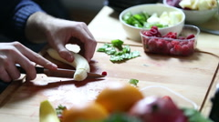 View of man hand cutting banana for fruit shake Stock Footage