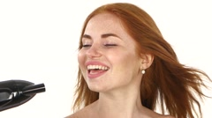 Smiling young Redhead girl singing while blow-dry. Close up,bathroom Stock Footage