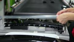 Female Worker Using Tool in Automotive Industry Stock Footage