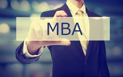 Business man holding MBA - stock photo