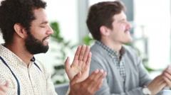 Male colleagues applauding during presentation in conference room - stock footage