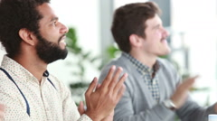 Male colleagues applauding during presentation in conference room Stock Footage