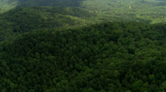 Flight over wooded hills and valleys in rural Georgia. Shot in 2007. - stock footage
