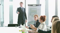 Business people talking during corporate presentation - stock footage
