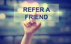 Hand pressing  Refer A Friend - stock photo