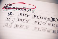calendar planner - 14 february, valentine day, buy flowers text, task - stock photo