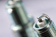 Auto service. Two new spark plugs as spare part of car. - stock photo