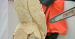 Wood sculptor chainsaw close up Stock Footage