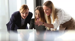 Three beautiful business woman cheering and high-fiving in office meeting Stock Footage