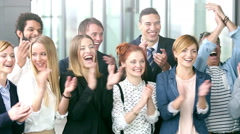 Portrait of happy business people clapping - stock footage