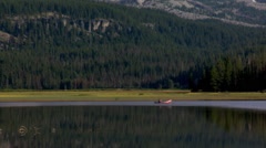 Zoom-out from canoeist on Sparks Lake to view of South Sister in Oregon Cascades Stock Footage