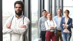 Portrait of african-american advertising executive, colleagues in background - stock footage