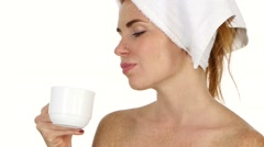 Young woman applying face cream. Close up, bathroom Stock Footage