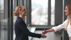 Two businesswoman shaking hands Stock Footage