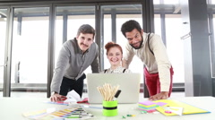 Young creative team smiling and looking at camera - stock footage