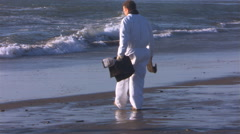 Stock Video Footage of Worker using soaker mat on oil-contaminated beach