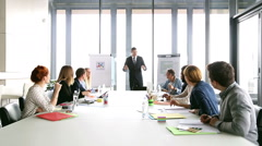 Business people applauding director during a meeting - stock footage
