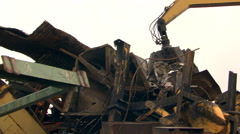 Crane loading scrap metal into truck Stock Footage