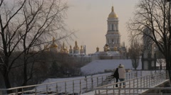 Two Girls Are Standing on a Bridge Wintery Park Teenagers Are Looking at Camera Stock Footage
