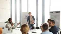 Colleagues applauding to their beautiful female colleague after presentation - stock footage