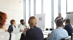Beautiful businesswoman giving presentation to colleagues using flipchart - stock footage