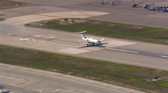 Aerial view of executive jet taking off from airstrip. Shot in 2007. - stock footage
