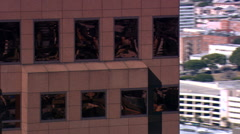 Flying near skyscraper composed of red stone and shiny metal. Shot in 2007. Stock Footage