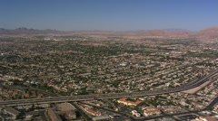 Flight over Las Vegas residential areas paralleling I-15. Shot in 2008. Stock Footage